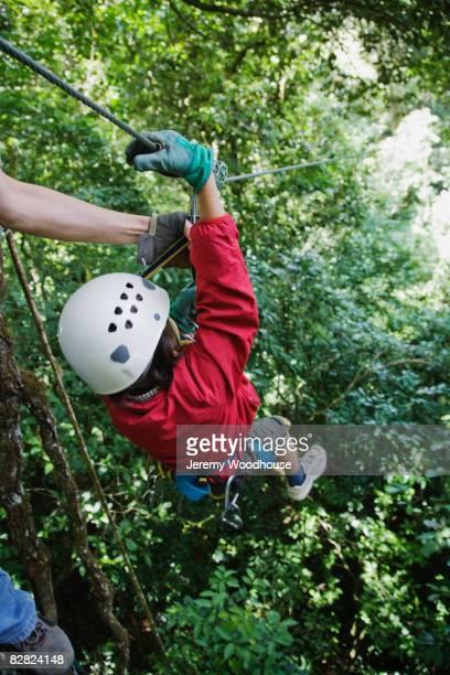 Child swinging on zip line