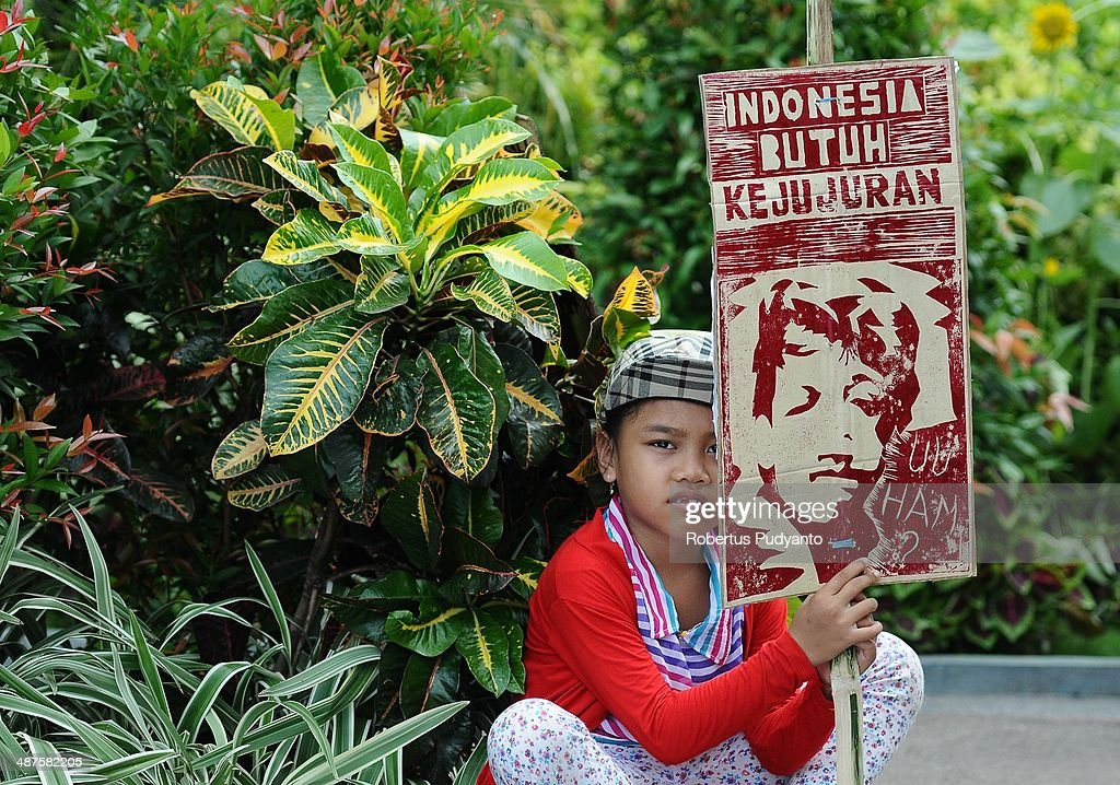 A child takes part in a demonstration to mark May Day on May 1, 2014 in Surabaya, Indonesia. Protesters across Indonesia have organised rallies to demand higher wages, as Indonesia recognises its first national labour day holiday.