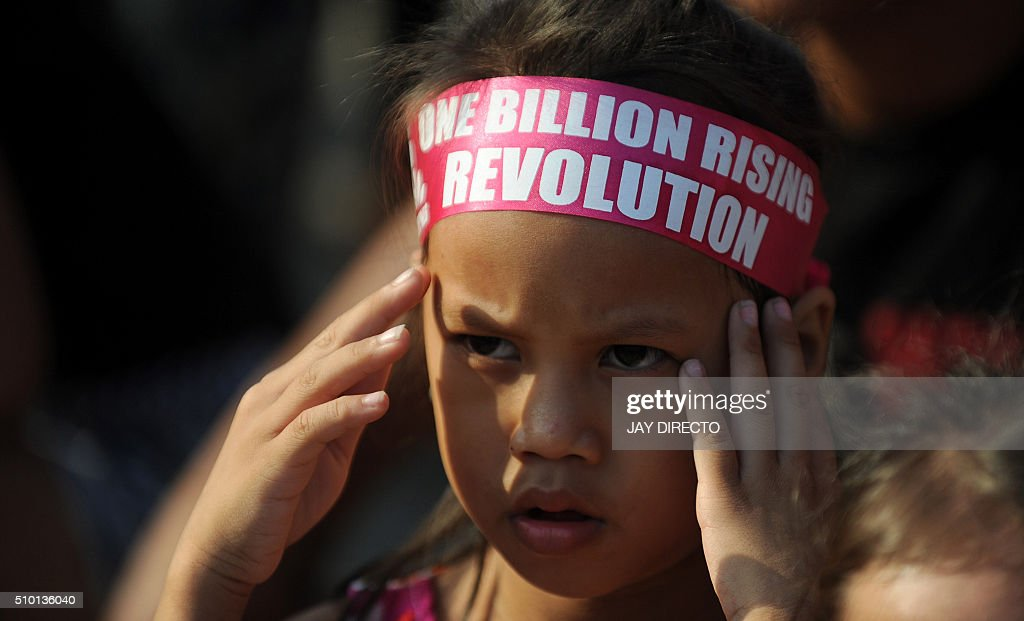 A child takes part in a gathering to mark the 'One Billion Rising' campaign in Manila on February 14, 2016. The campaign aims to end violence against women and children. AFP PHOTO / Jay DIRECTO / AFP / JAY DIRECTO