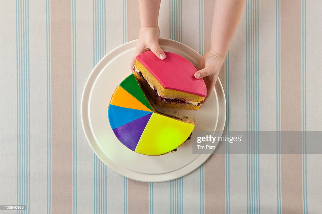 A child takes slice of a 'pie chart' cake. : Stock Photo