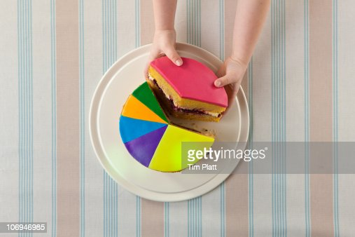 A child takes slice of a 'pie chart' cake. : Foto stock