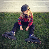 Child taking a break from riding in-line skates
