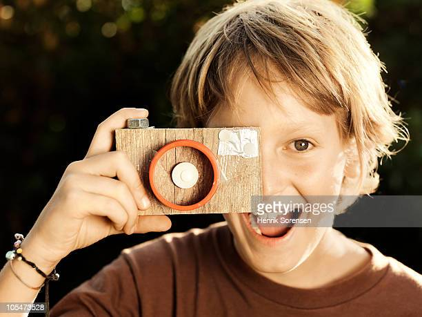Child taking picture with homemade camera