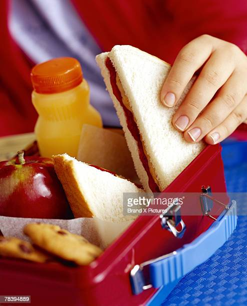 Child taking sandwich out of lunchbox