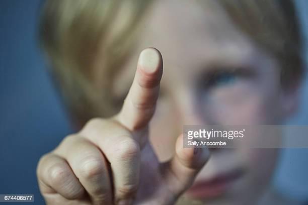 Child touching a screen