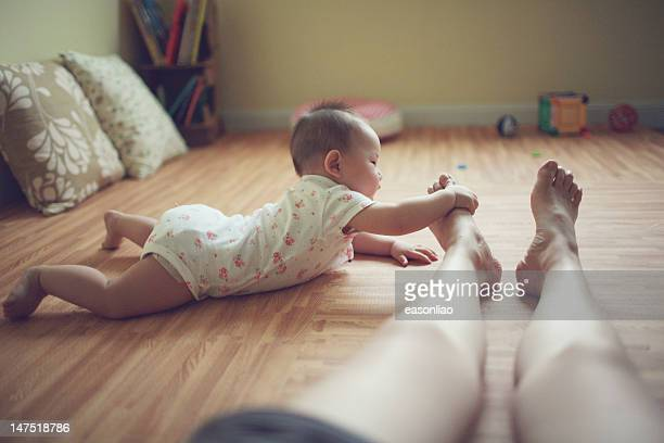 Child touching mother's feet