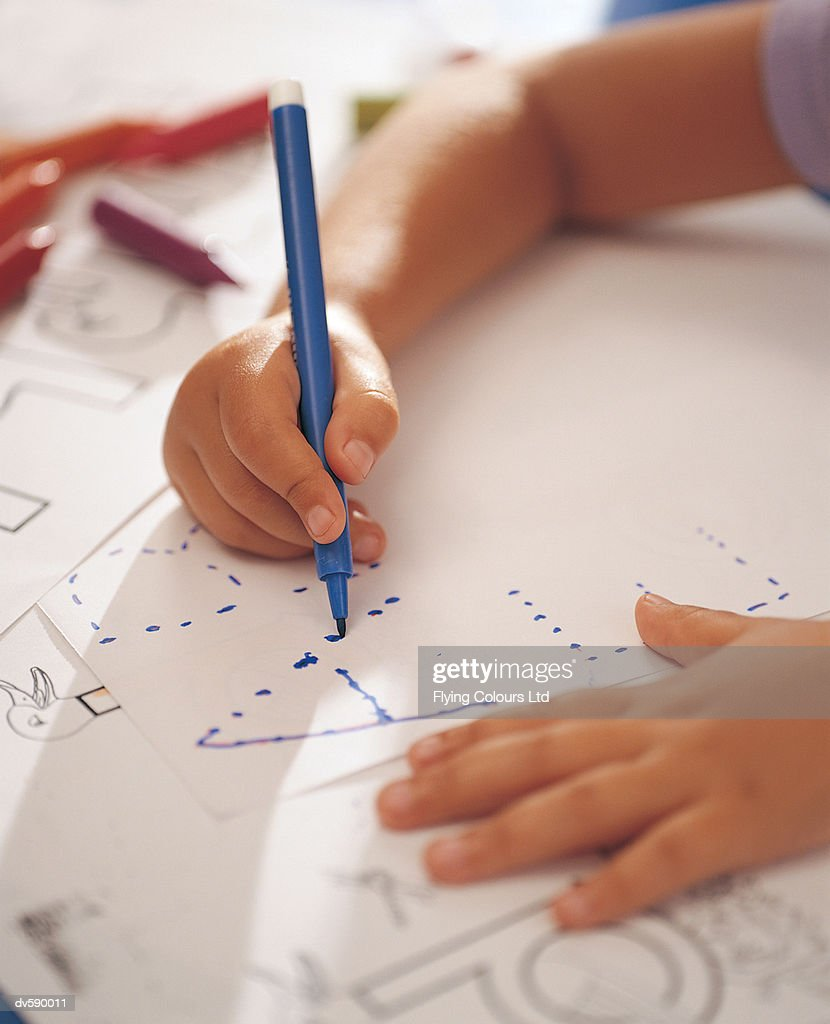 Child Tracing Letters of the Alphabet : Stock Photo