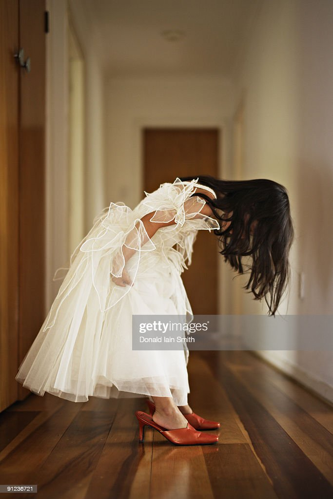 Child tries on her mother's shoes