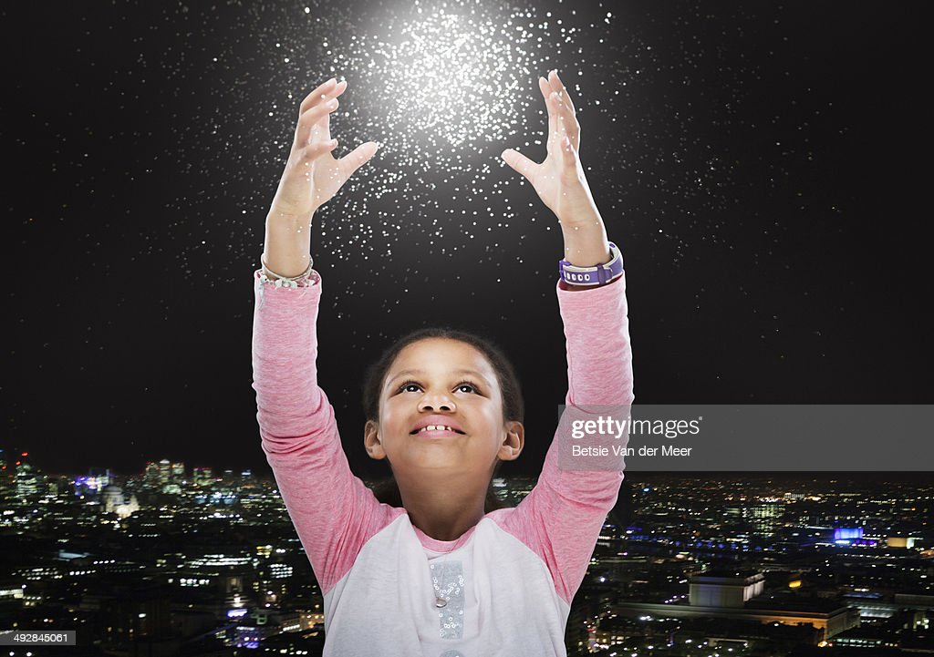 child trying to touch energy star ball. : Stock Photo