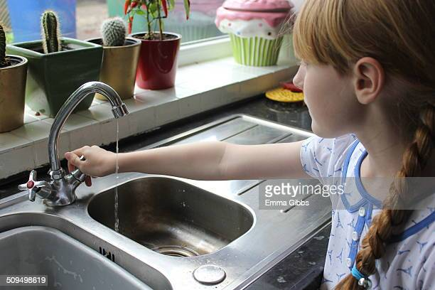 Child turning off a tap