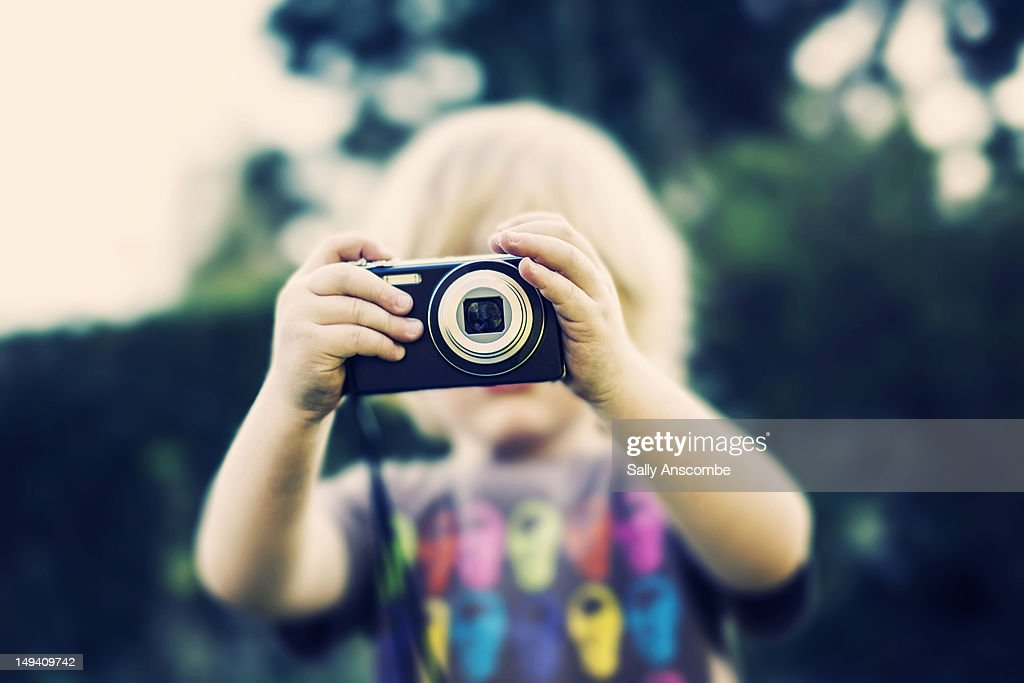Child using camera : Stock Photo