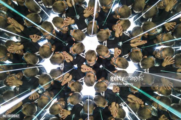 A child visitor views the Kaleidoscope installation an exhibition part of the Museum of Illusions in Vienna Austria on October 16 2017 The Museum of...