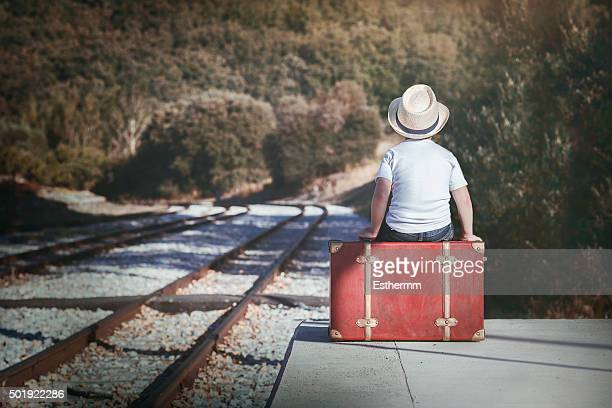 child waiting for the train