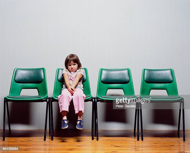 Child waiting on chairs