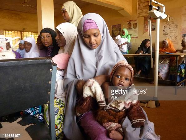 A child waits for vaccination at a public health centre where children are being vaccinated against polio in Kano northern Nigerian on February 13...
