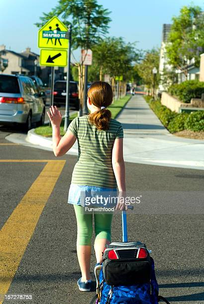 Child Walking Back to School: Popular Girl Crossing Street Crosswalk