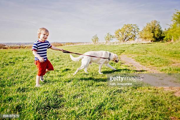 Child walking his pet dog