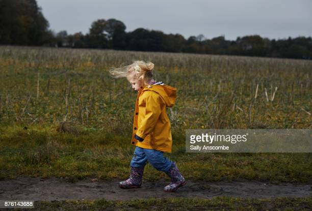 Child walking through a field