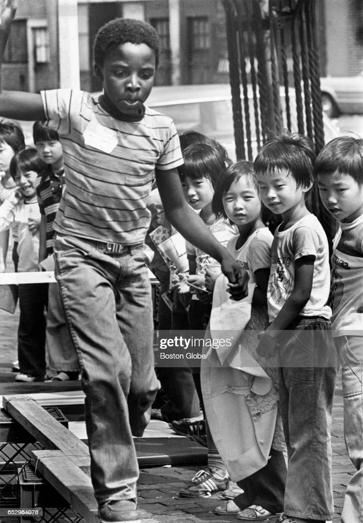 A child walks an obstacle course while others look on during a Summerthing event in Boston's South End on Aug. 9, 1978.