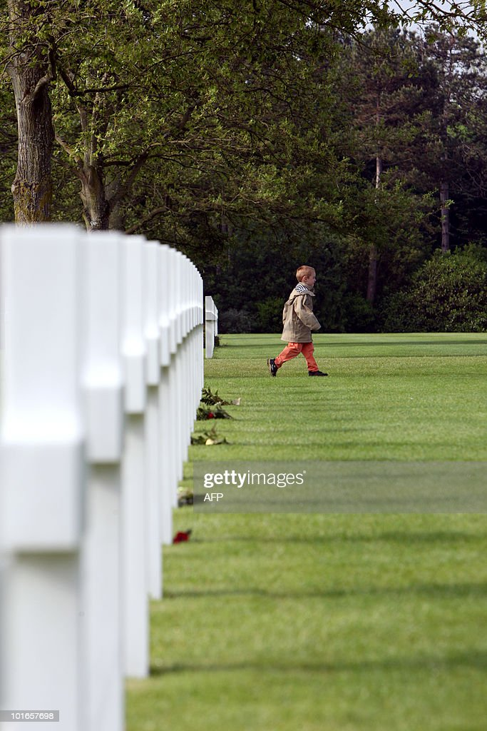 A child walks at the American cemetery in Colleville-sur-Mer, Normandy, western France, on June 6, 2010, during a commemoration of the 66th anniversary of the D-Day Allied landings on the beaches of Normandy. More than 45,000 Allied soldiers, including 29,000 Americans, were killed during Operation Overlord, which saw the opening of a second front on mainland Europe and led to the liberation of France.