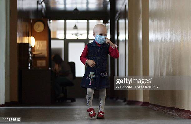 A child walks in a hospital for people suffering from leukemia in the eastern Ukrainian city of Donetsk on March 23 2011 Ukrainian children and...