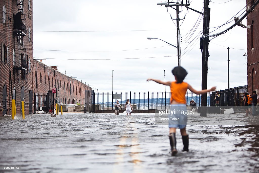 A child walks through a flooded street in Red Hook section of Brooklyn after hurricane Irene made landfall in New York City on Sunday August 28 2011...