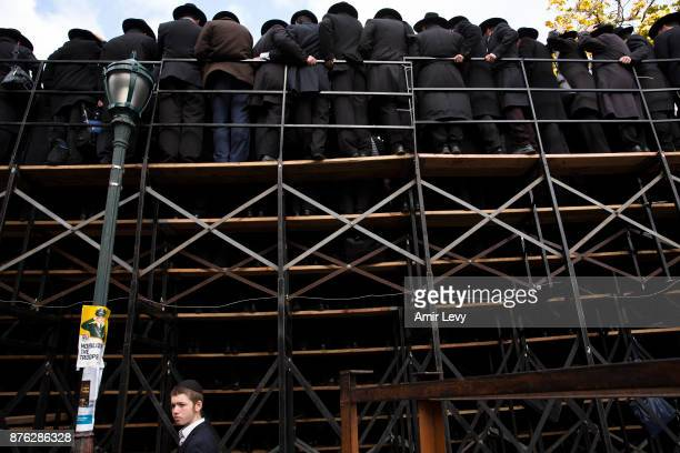 A child walks under the scaffold as Hasidic rabbis prepare to pose a group photo part of the annual International Conference of ChabadLubavitch...