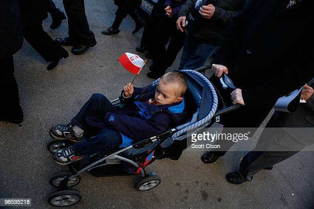 A child wave a Polish Flag during a march toward Holy Name Cathedral following a short funeral mass held to honor Polish President Lech Kaczynski his...