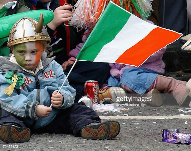 A child waves a flag during the St Patricks Day Parade on March 17 2005 in Dublin Ireland