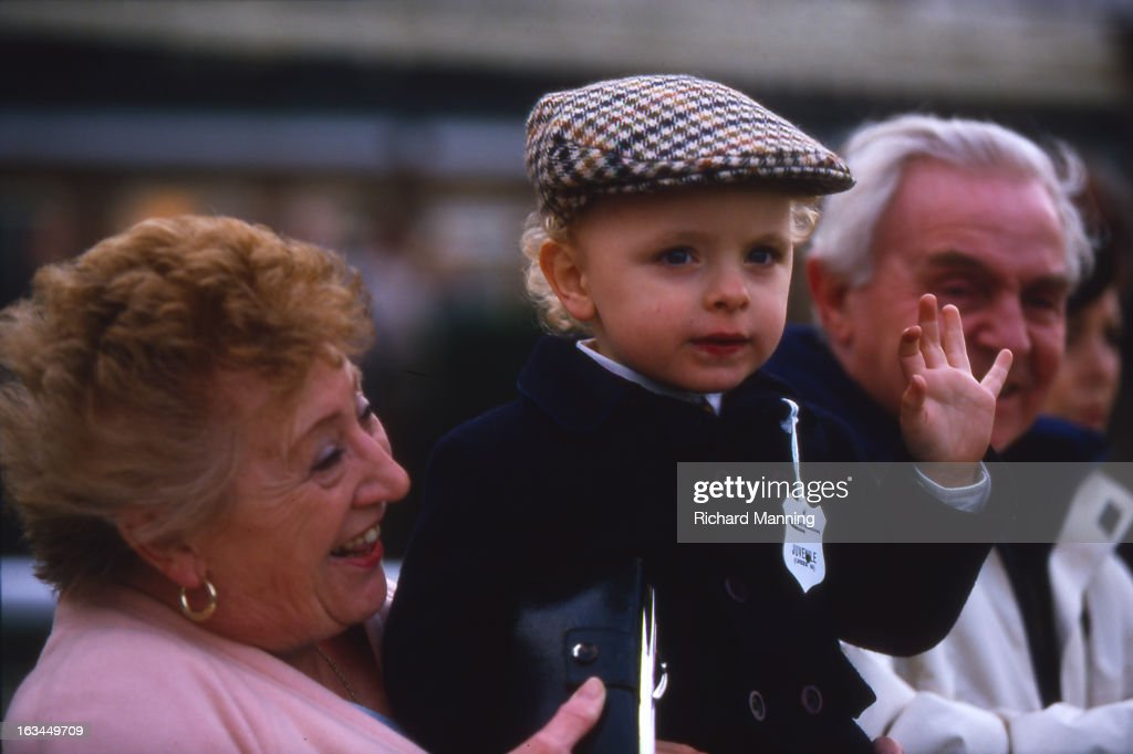 A child waves whilst attending the Grand Military Gold Cup, held annually at Sandown Park Racecourse in Esher, Surrey. It is a meeting point for the Military, in particularly for Cavalry Officers, with its origins in the days when mounted Cavalry Officers still rode to war.