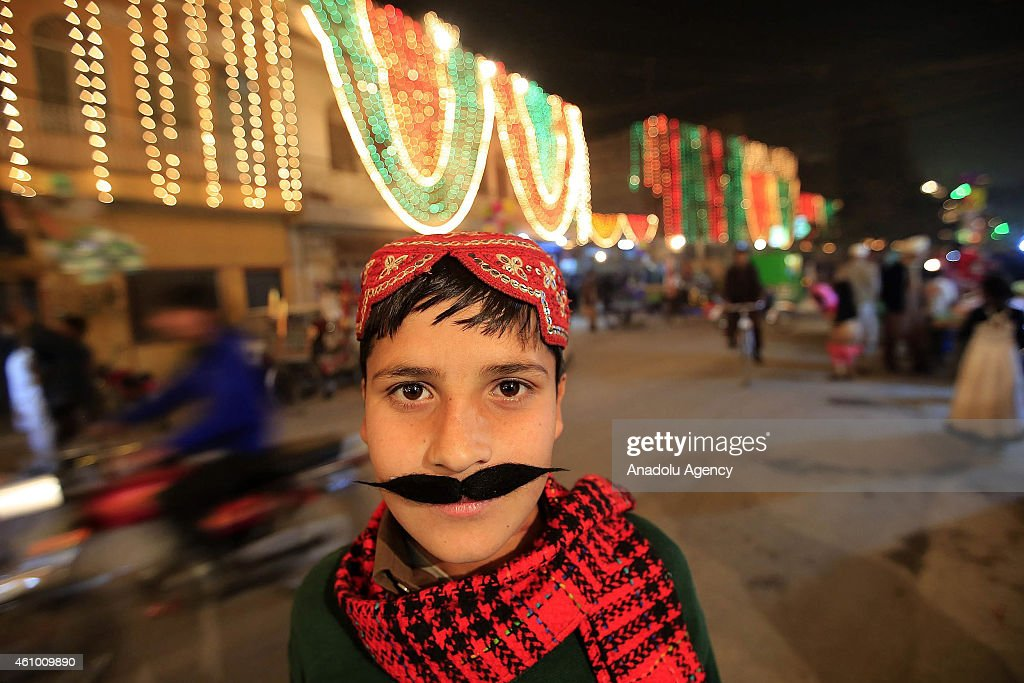 A child wearing false beard is seen as streets and buildings are decorated with lights and ornaments within the ceremony marking the 1444th anniversary of the birthday of Prophet Mohammad, Mawlid al Nabi, in Rawalpindi, Pakistan on January 3, 2015.