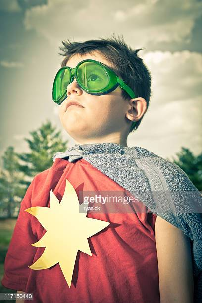 Child Wearing Green Goggles Pretending to be a Superhero