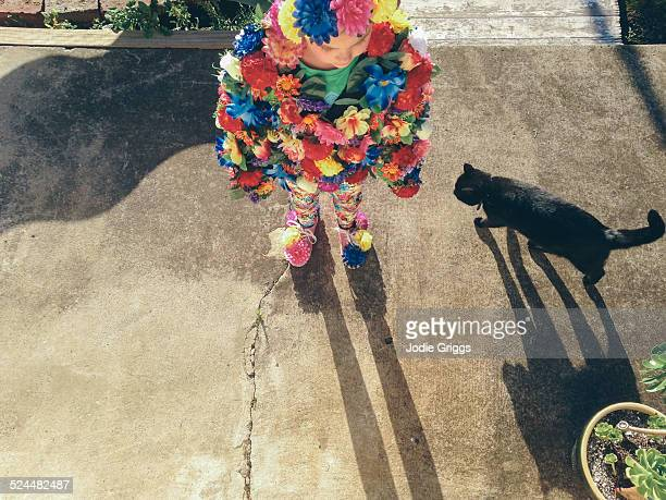 Child wearing home-made costume covered in flowers