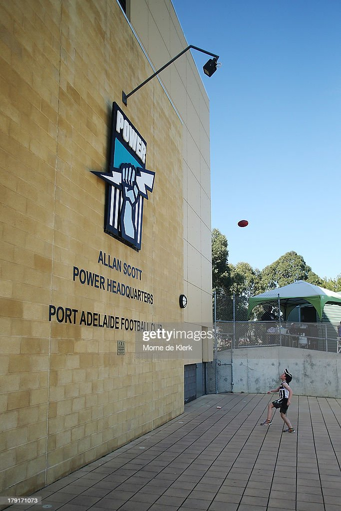 A child, wearing Magpies jumper plays in front of the Port Power sign during the round 22 SANFL match between the Port Adelaide Magpies and the West Adelaide Bloods at Alberton Oval on September 1, 2013 in Adelaide, Australia.