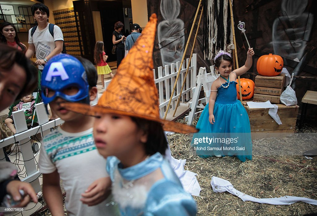 a child wears a halloween costume at a shopping mall during halloween celebrations on october 31 - What Is Halloween A Celebration Of