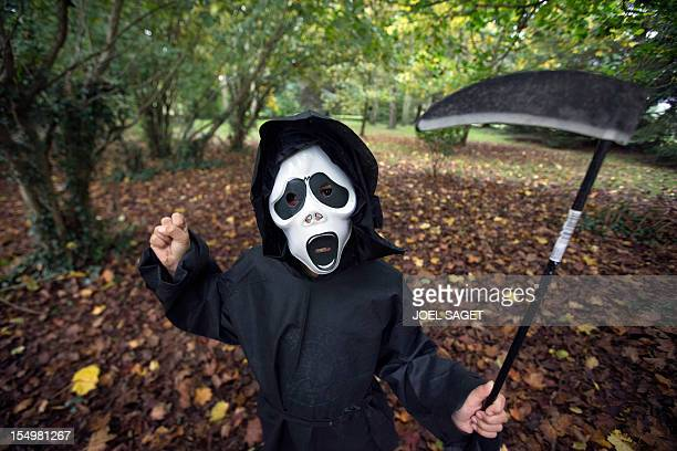 A child wears a mask and a costume representing 'death' on October 24 2012 in SaintPhilbertsurRisle Normandy a week before the Halloween festival AFP...