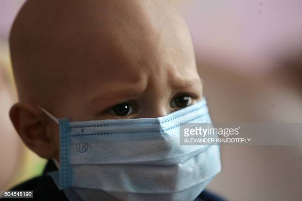 A child wears a mask in a hospital for people suffering from leukemia in the eastern Ukrainian city of Donetsk on March 23 2011 Ukrainian children...