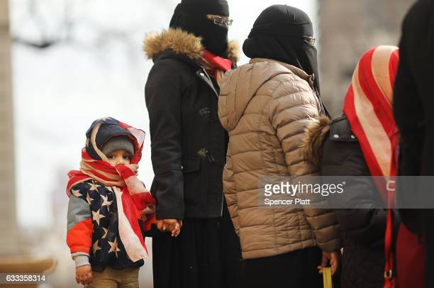 A child wears an American Flag head scarf while standing with his mother at an event at City Hall for World Hijab Day on February 1 2017 in New York...
