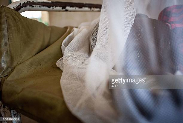 A child who was accidentally injured by his brother rests on a bed at the Bor Hospital on February 26 in South SudanWar crimes have been committed by...