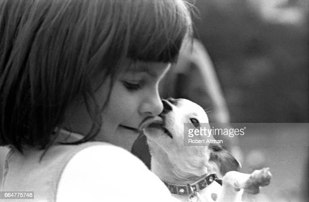 A child with a dog has her face licked circa February 1969 at Golden Gate Park in San Francisco California