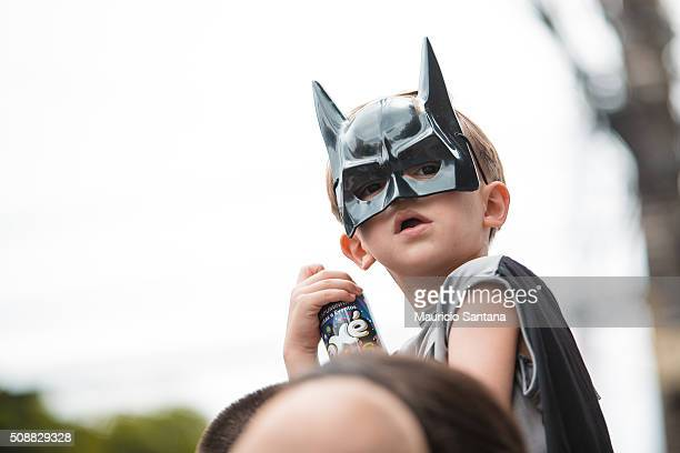 A child with batman costume has fun during the street carnival Street carnival in Sao Paulo many groups called blocos has bands and thousands of...