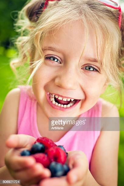 Child with berries