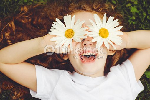 Child with daisy eyes.