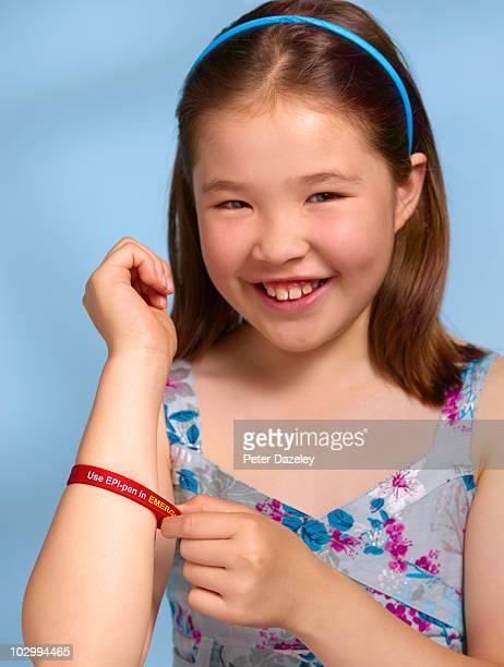 Child with epi-pen wrist band