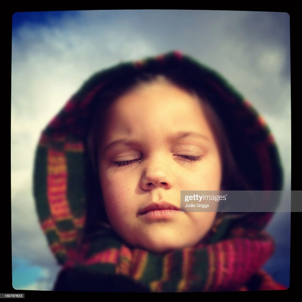 Child with eyes closed : Stock Photo