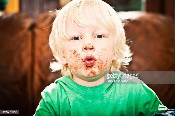 Child with face covered in chocolate