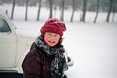 Child with glasses in the snow