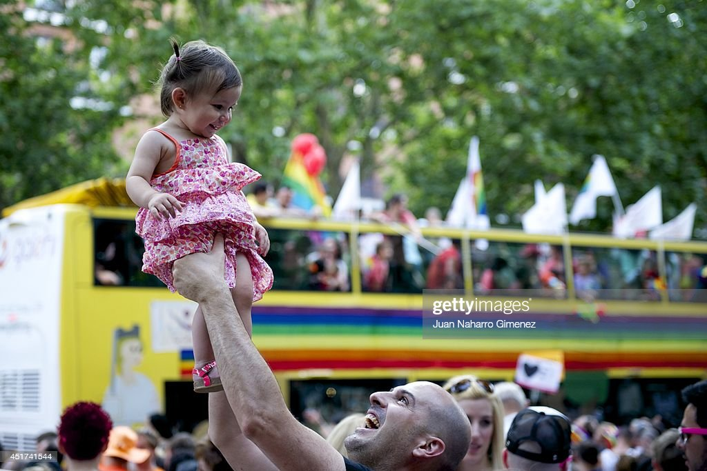 A child with her father take part in the Gay Pride Parade in Madrid on July 5, 2014 in Madrid, Spain. State Protest LGBT Pride 2014 this year has the theme 'Nos Manifestamos Por Quienes No Pueden' (We march for those who can not) After last week held most of the demonstrations outside Madrid, the communities around the country come together to pool their efforts in the biggest Pride of Europe.