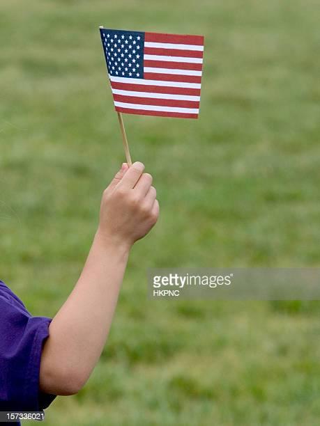 Child With Miniature Patriotic American Flag