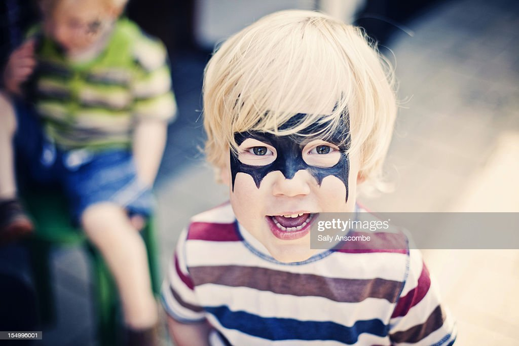 Child with painted face : Stock Photo